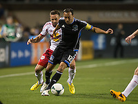 March 10th, 2013: Ramiro Corrales controls the ball away from Jonny Steele during a game at Buck Shaw Stadium, Santa Clara, Ca.   Earthquakes defeated Red Bulls 2-1