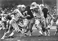 Houston Oiler quarterback Pete Bethard is rushed by <br />