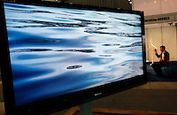 Screen with commercial from Norwegian company Statkraft showing water, as a man in the background is discussing wind turbines. Renewable sources will be helping to meet the world's demand for energy in the future. This development opens new markets and opportunities for business. Hoping to make &quot;green business&quot; and &quot;green profit&quot; over 60 exhibitors took part in the The North European Renewable Energy Convention (Nerec) , in Norway, presenting their solutions for renewable energy in the future. .&copy; Fredrik Naumann/Felix Features