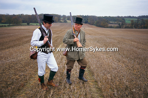 Shooting party private estate Wiltshire. Its a Black Powder shoot and their tradition is to wear top hats on this occasion.