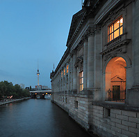 Bode Museum, completed 1904 by Ernst von Ihne, housing collections of sculpture, Byzantine art, and coins and medals, Museum Island, Mitte, Berlin, Germany. Originally called the Kaiser-Friedrich-Museum after Emperor Frederick III, the museum was renamed in honour of its first curator, Wilhelm von Bode, in 1956. In the distance is the Fernsehturm or TV Tower, built 1965-69 in the former East Berlin. The buildings on Museum Island were listed as a UNESCO World Heritage Site in 1999. Picture by Manuel Cohen