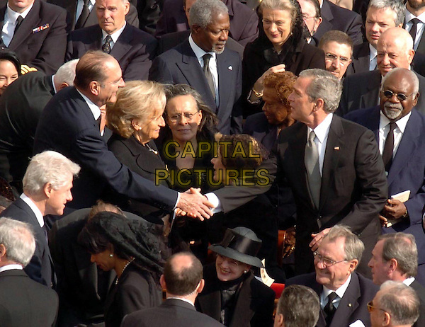 JAQUES CHIRAC & GEORGE W. BUSH .At the funeral of Pope John Paul the Second, St. Peter's Square,Vatican City, Rome, Italy,.April 8th 2005..half length president of the United States of America USA shaking hands french prime Minister.Ref: OME.www.capitalpictures.com.sales@capitalpictures.com.©Omega/Capital Pictures.