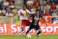 Roy Miller (7) of the New York Red Bulls gets tangled up with Daniel Cruz (44) of the Philadelphia Union. The New York Red Bulls and the Philadelphia Union played to a 0-0 tie during a Major League Soccer (MLS) match at Red Bull Arena in Harrison, NJ, on August 17, 2013.