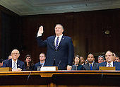 United States Representative Mike Pompeo (Republican of Kansas) is sworn-in to testify before the US Senate Select Committee on Intelligence during a confirmation hearing on his nomination to be Director of the Central Intelligence Agency (CIA) on Capitol Hill in Washington, DC on Thursday, January 12, 2017.  US Senator Pat Roberts (Republican of Kansas), left, and former US Senate Majority Leader Bob Dole (Republican of Kansas), right, look on from the witness table.<br /> Credit: Ron Sachs / CNP
