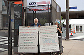 James Germalic, left and Lenore Kalam of Cleveland, Ohio, representing &quot;The Black / White Party&quot; carry signs outside the Quicken Loans Arena, site of the 2016 Republican National Convention on Saturday, July 16, 2016.  Their religious party rejects both Donald Trump and Hillary Clinton.<br /> Credit: Ron Sachs / CNP<br /> (RESTRICTION: NO New York or New Jersey Newspapers or newspapers within a 75 mile radius of New York City)