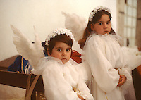 Two angels in a church pagent in Portugal.