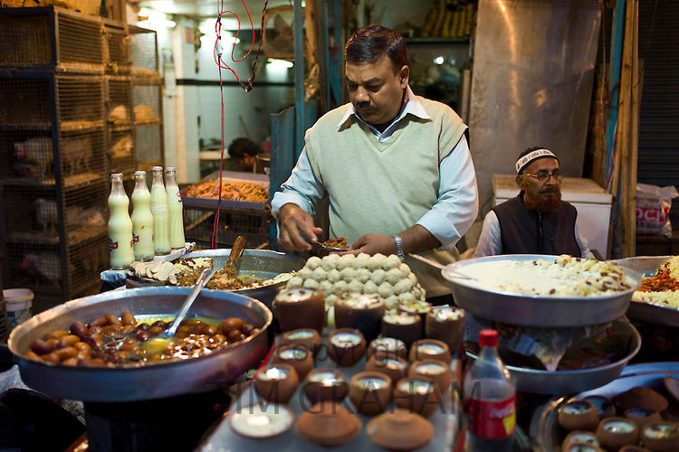 Food on sale at meat stall in Snack market at muslim Meena Bazar, in Old Delhi, India
