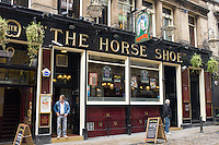 Customers at the Horse Show public house,  traditional pub, in Drury Street off Buchanan Street in Glasgow, Scotland, UK