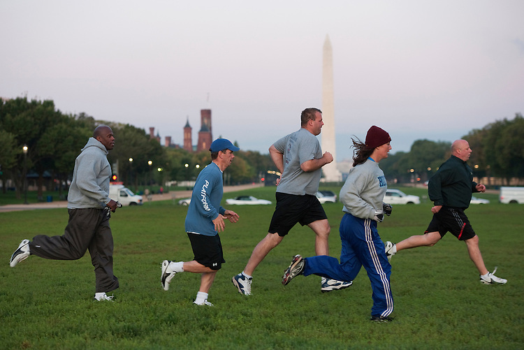 UNITED STATES - OCTOBER 04:  From left, former Redskin Ken Harvey, Reps. Bob Dold, R-Ill., Jon Runyan, R-N.J., Donna Wilkinson of the women's football team DC Divas, and Rep. Scott Desjarlais, R-Tenn., run during a congressional football practice on the Mall in preparation for the upcoming game between members of Congress and the Capitol Police.  (Photo By Tom Williams/Roll Call)