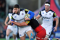 Matt Banahan of Bath Rugby is tackled by Jacques Burger of Saracens. Aviva Premiership match, between Saracens and Bath Rugby on January 30, 2016 at Allianz Park in London, England. Photo by: Patrick Khachfe / Onside Images