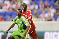 New York Red Bulls goalkeeper Bouna Coundoul (18) fights for position with Sanna Nyassi (23) of the Seattle Sounders. The Seattle Sounders defeated the New York Red Bulls 1-0 during a Major League Soccer (MLS) match at Red Bull Arena in Harrison, NJ, on May 15, 2010.