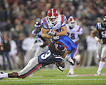 Louisiana Tech's Hunter Lee (36) is tackled by Ole Miss'  Charles Sawyer (3) in Oxford, Miss. on Saturday, November 12, 2011.