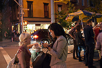 Hordes of shoppers descend on Bleecker Street in New York on Thursday, September 8, 2011 during the third annual Fashion's Night Out event. On the first evening of New York Fashion Week stores around the city offered sales and bargains as well as parties and events to entice customers to shop. The event has been so successful in boosting sales that over 250 cities in the US are having their own events and over 1000 retailers participated in New York. (© Richard B. Levine)