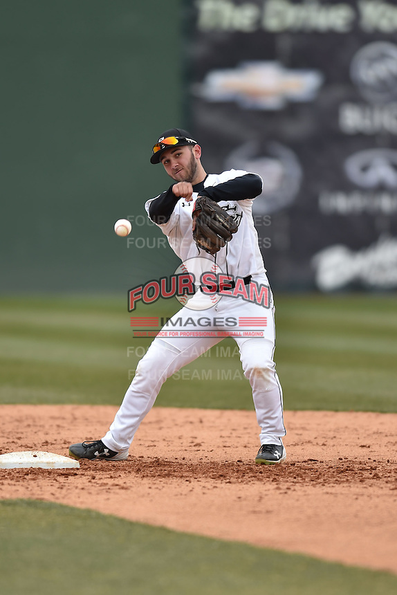 South Carolina Gamecocks second baseman Max Schrock (22) warms up on the field before a game against the Clemson Tigers at Fluor Field February 28, 2015 in Greenville, South Carolina. The Gamecocks defeated the Tigers 4-1. (Tony Farlow/Four Seam Images)