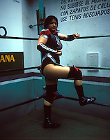 "Muñeca at the ""Gymnasio Latinoamericano"" a well known and popular gym for male and female boxers and ""luchadores"" (wrestlers) in the Center of Mexico City. August 2004"