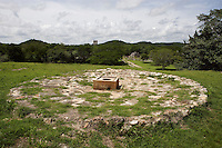 Chultun, underground reservoir for water storage, in front of the Great Palace, with the Watchtower and the Monumental Arch (right) in the distance, 300 - 1000 AD, Labna, Yucatan, Mexico. Picture by Manuel Cohen