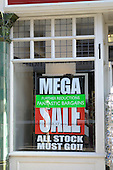 Mega Sale sign in shop window.