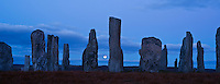 Fullmoon rises behind Callanish standing stones, Isle of Lewis, Outer Hebrides, Scotland