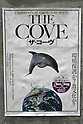 July 3, 2010 - Tokyo, Japan - A poster of the Oscar-winning dolphin hunting documentary 'The Cove' is pictured near cinema running the movie in Tokyo, Japan, on July 3, 2010. Despite pressure from groups who say the film is anti-Japanese, 'The Cove' will be shown at six theaters in Tokyo and five other Japanese cities beginning Saturday, followed by Nagoya Cinematheque and 15 other theaters across Japan from Aug. 14.