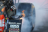 Feb 11, 2017; Pomona, CA, USA; Fire comes from the engine on the dragster of NHRA top fuel driver Terry McMillen during qualifying for the Winternationals at Auto Club Raceway at Pomona. Mandatory Credit: Mark J. Rebilas-USA TODAY Sports