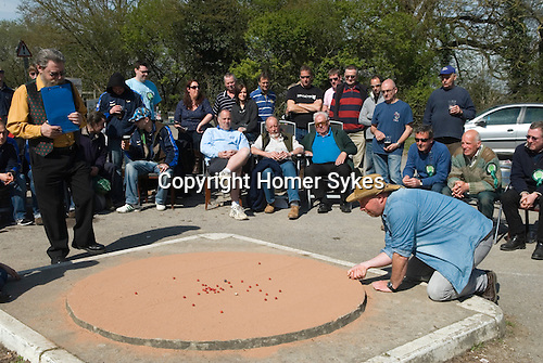 World Champion Marbles Championship, Good Friday, Tinsley Green, Sussex UK. Played outside the Greyhound pub.