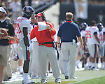 Ole Miss asistant coach Gunter Brewer talks with Ole Miss' Vince Sanders (10) in Nashville, Tenn. on Saturday, September 17, 2011. Vanderbilt won 30-7..