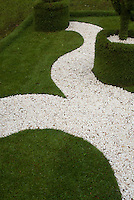 White pebble path in lawn grass, shines at night