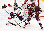 ?, Gina McDonald (Harvard - 10) - The Harvard University Crimson defeated the Northeastern University Huskies 4-3 (SO) in the opening round of the Beanpot on Tuesday, February 8, 2011, at Conte Forum in Chestnut Hill, Massachusetts.