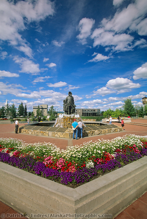 Tourists visit the Golden Heart Park and  First Family statue, downtown Fairbanks, Alaska