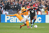 D.C. United Branko Boskovic (8) goes against Houston Dynamo midfielder Ricardo Clark (13) D.C. United tied The Houston Dynamo 1-1 but lost in the overall score 4-2 in the second leg of the Eastern Conference Championship at RFK Stadium, Sunday November 18, 2012.