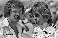 INDIANAPOLIS, IN - May 28: Janet Guthrie speaks with a crew member in the pit lane during practice for the 1978 Indianapolis 500 on May 28, 1978, at the Indianapolis Motor Speedway in Speedway, Indiana.