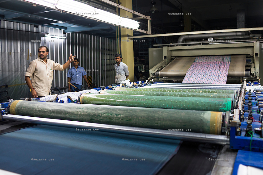 Workers printing textiles on the Roll Printer of the Pratibha vertically integrated garment unit in Indore, Madhya Pradesh, India on 11 November 2014. Photo by Suzanne Lee for Fairtrade