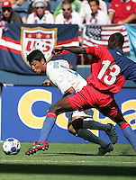 Roger Espionza (left) tries to get past Pierre Richard Bruny (13). Honduras defeated Haiti 1-0 during the First Round of the 2009 CONCACAF Gold Cup at Qwest Field in Seattle, Washington on July 4, 2009.
