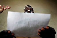 A man tries on a pair of donated glasses during an eye examination by ophthalmologist Doctor Richard Hardi in the remote village of Pania. <br /> <br /> From his base in Mbuji Mayi Hungarian ophthalmologist Friar Richard Hardi and his team travelled deep into the Congolese rainforest, by 4x4 and canoe, to treat people in isolated communities most of whom have never seen an ophthalmologist. At a small village called Pania they established a temporary field hospital and over the next three days made hundreds of consultations. Although both conditions are preventable, many of the patients they saw had Glaucoma or River Blindness (onchocerciasis) that had permanently damaged their eyesight. However, patients with cataracts, a clouding of the eye's lens, who were suitable for treatment were booked for an operation. For two days the team carried out the ten minute procedure on one patient after another. The surgery involves making a 2.2mm incision into the remove the damaged lens that is then replaced by an artificial one. Doctor Hardi is one of the few people willing to make such a journey but is inspired to do so by his faith and, as he says: 'Here I feel that I can really make a difference in people's lives'. /Felix Features