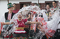 Woman wearing traditional dresse of the Matyo people is being splashed with buckets of water as part of the fertility traditions during the Easter watering celebration in Mezokovesd (about 130 km East of capital city Budapest), Hungary on April 13, 2017. ATTILA VOLGYI
