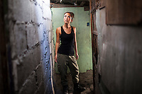 Myleene Klass, a high profile UK celebrity, TV host, violinist and pianist, walks through narrow urban slum alleyways as she visits under-priviledged families and mothers in Paranaque, Metro Manila, The Philippines on 19 January 2013. Photo by Suzanne Lee for Save the Children UK