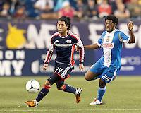 New England Revolution midfielder Lee Nguyen (24) dribbles as Philadelphia Union defender Sheanon Williams (25) closes. In a Major League Soccer (MLS) match, the New England Revolution tied Philadelphia Union, 0-0, at Gillette Stadium on September 1, 2012.