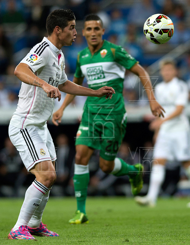 MADRID - ESPAÑA - 23-09-2014: James Rodriguez, jugador de Real Madrid durante partido de la Liga de España, Real Madrid y Elche en el estadio Santiago Bernabeu de la ciudad de Madrid, España. / James Rodriguez, player of Real Madrid during a match between Real Madrid and Elche for the Liga of Spain in the Santiago Bernabeu stadium in Madrid, Spain  Photo: Asnerp / Patricio Realpe / VizzorImage.
