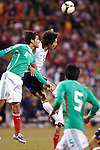 Rafael Salcido (4) and Clint Dempsey (8) go up for the ball in the US Men's National Team vs. Mexico at Crew Stadium in Columbus, Ohio in World Cup Qualifier. USA 2 - Mexico 0