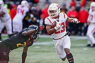 College Park, MD - November 26, 2016: Rutgers Scarlet Knights wide receiver Dacoven Bailey (23) avoids Maryland Terrapins defensive back RaVon Davis (21) during game between Rutgers and Maryland at  Capital One Field at Maryland Stadium in College Park, MD.  (Photo by Elliott Brown/Media Images International)