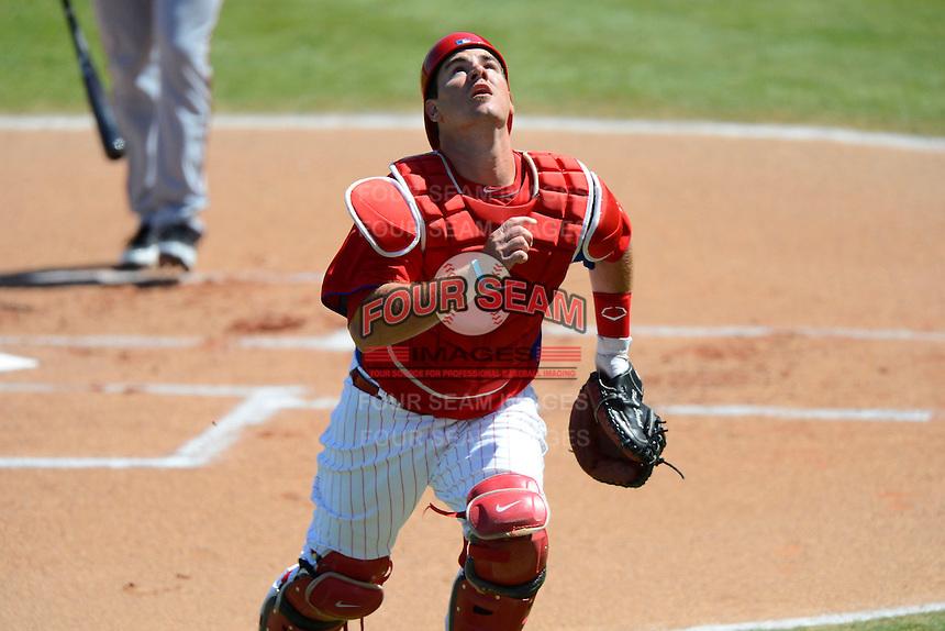 Philadelphia Phillies catcher Tommy Joseph #73 tracks down a foul ball pop up during a Spring Training game against the Washington Nationals at Bright House Field on March 6, 2013 in Clearwater, Florida.  Philadelphia defeated Washington 6-3.  (Mike Janes/Four Seam Images)