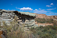 Wolfe Ranch, an old log cabin built next to a seasonal creek by early settlers in 1888.<br /> Arches National Park<br /> Moab Utah<br /> USA
