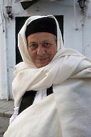 Tripoli Medina, Libya - Eid al-Adha, Id al-Adha.  Libyan Man Wearing Traditional Holi After Eid Prayers.