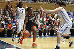 24 February 2012: Miami's Riquna Williams (center) is defended by Duke's Haley Peters (right) and Elizabeth Williams (left). The Duke University Blue Devils defeated the University of Miami Hurricanes 74-64 at Cameron Indoor Stadium in Durham, North Carolina in an NCAA Division I Women's basketball game.