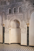 The mihrab with its intricately carved stucco work in the Al-Attarine Madrasa, a religious school built 1323-25 by the Marinid Sultan Uthman II Abu Said, who ruled 1310-31, in the medina of Fes, Fes-Boulemane, Northern Morocco. The mihrab is a niche which marks the direction of Mecca. The medina of Fes was listed as a UNESCO World Heritage Site in 1981. Picture by Manuel Cohen