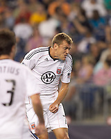 DC United forward Adam Cristman (7) heads the ball toward the goal. The New England Revolution defeated DC United, 1-0, at Gillette Stadium on August 7, 2010.