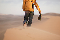Namibia - Traveller on dunes near Swapkopmund
