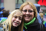March 16, 2013 - New York, NY, U.S. - OLIVIA GUILFORDICT, 14, is marching with her aunt CINDY EICHKHOLTZ, of Branford Ct, in the 252nd annual NYC St. Patrick's Day Parade, thousands of marchers show their Irish pride, as they march up Fifth Avenue, and over a million people, often in green and orange, watch and celebrate.