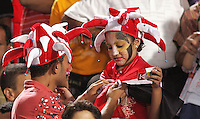 Egyptian fans repair their outfits before the match against Costa Rica during the FIFA Under 20 World Cup Round of 16 match at the Cairo International Stadium on October 06, 2009 in Cairo, Egypt.