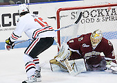 Brodie Reid (Northeastern - 15), John Muse (BC - 1) - The Northeastern University Huskies defeated the visiting Boston College Eagles 2-1 on Saturday, February 19, 2011, at Matthews Arena in Boston, Massachusetts.